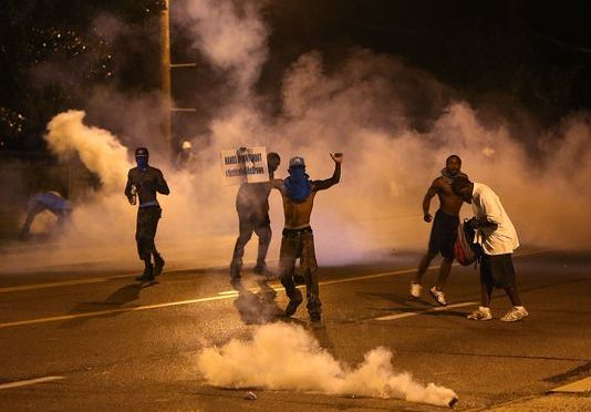 Picking up the pieces in riot-struck Ferguson